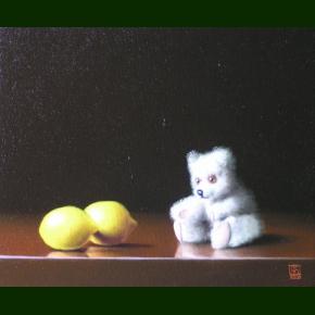Bamse som betragter to citroner