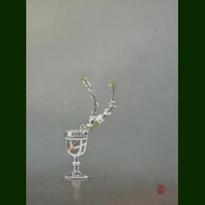 Slåenblomster i gammelt vinglas