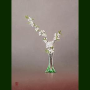Slåenblomster i grøn glasvase